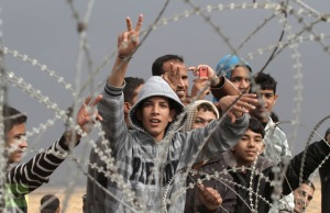 palestinian-youths-security-fence